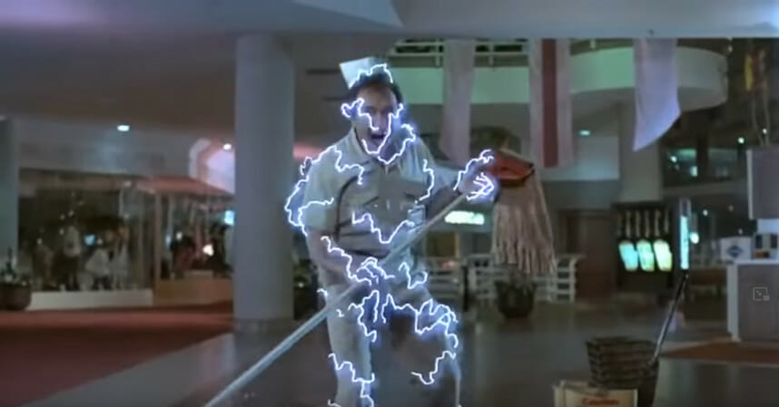 A janitor getting electrocuted by a robot